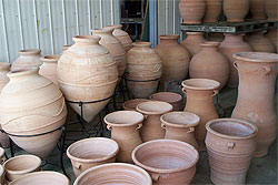 The warehouse fills with cretan pots